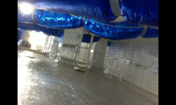 Inside new build with blue exposed duct work